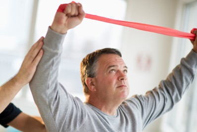 Man using elastic band to exercise