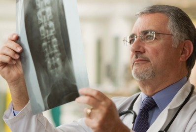 Doctor looking at image of spine